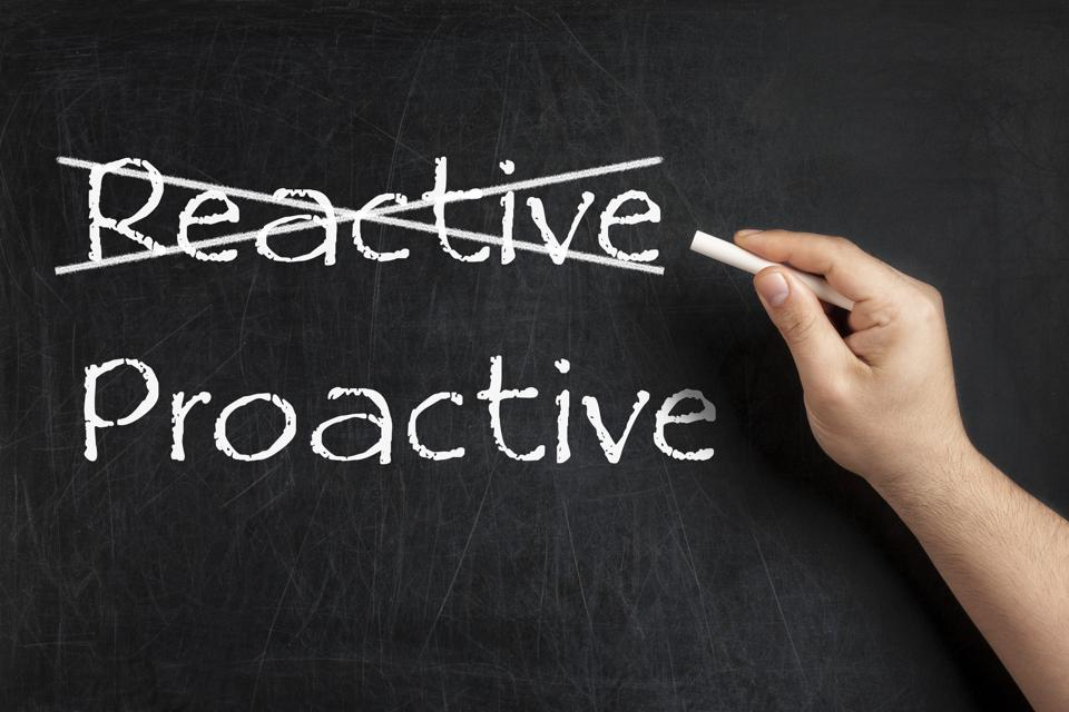 Being Proactive not Reactive crossed blackboard chalkboard