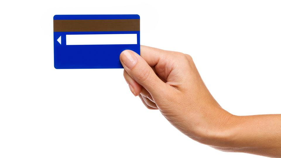 Magnetic stripe card in woman's hand
