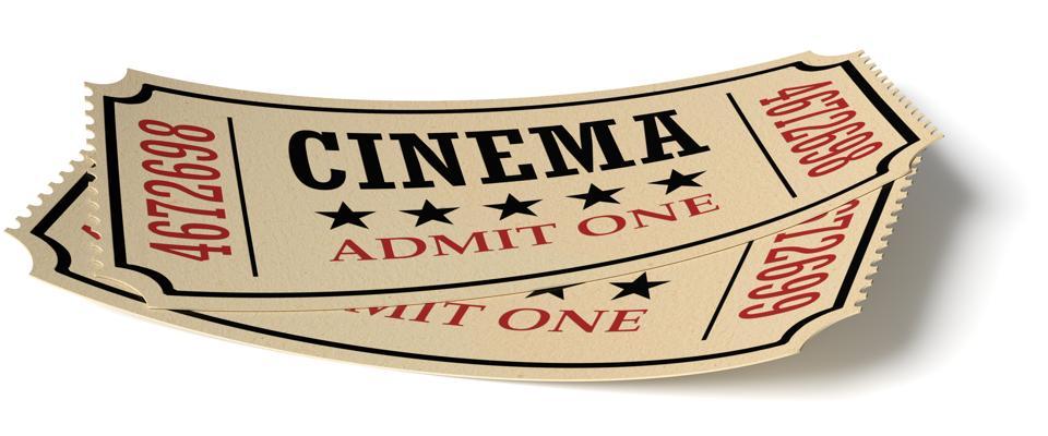 Pair of retro vintage cinema tickets with shadow