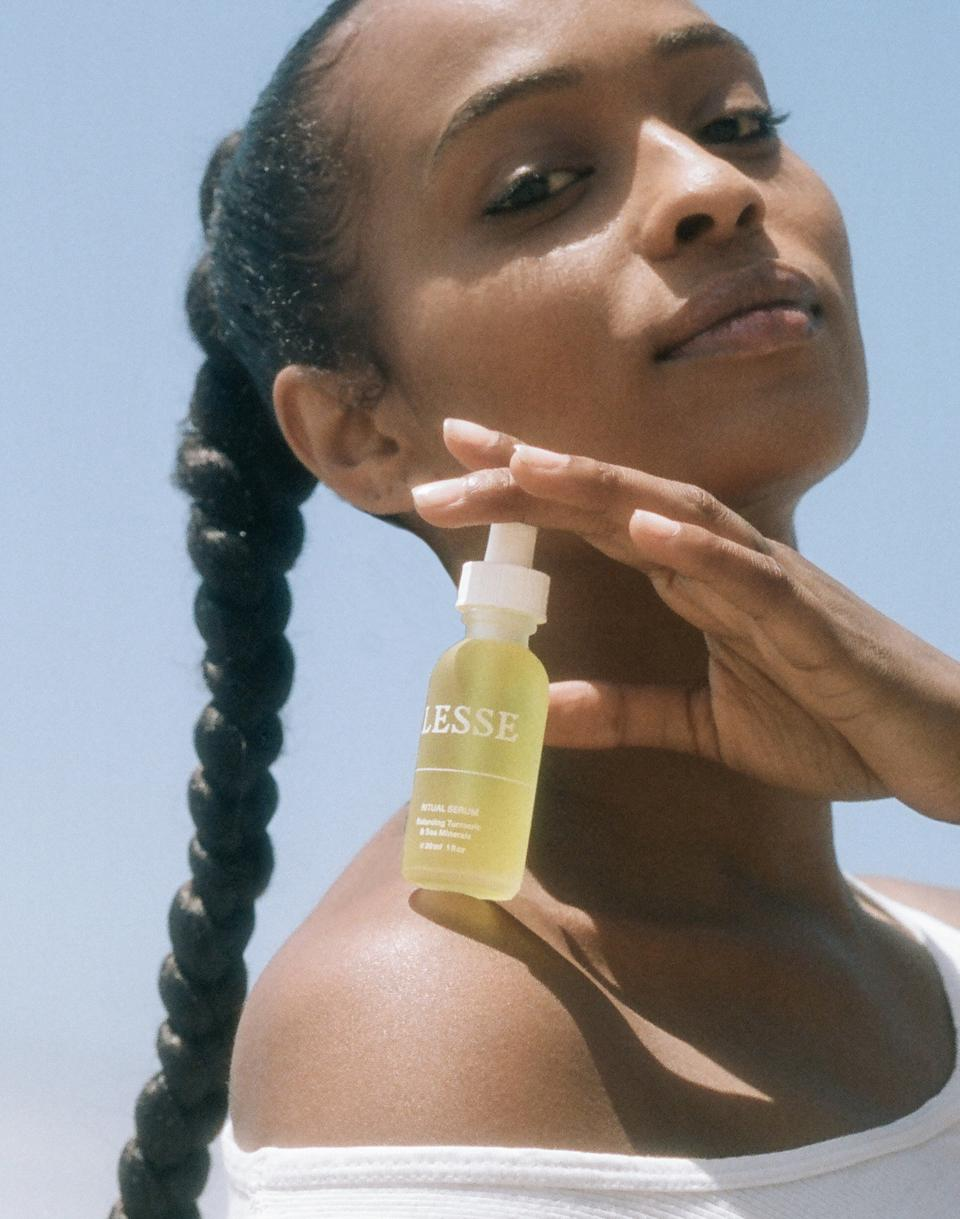 Photo of woman holding ritual serum