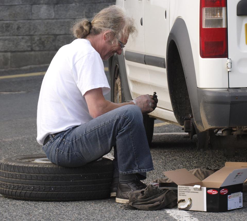 Man installs new brake pads on his car