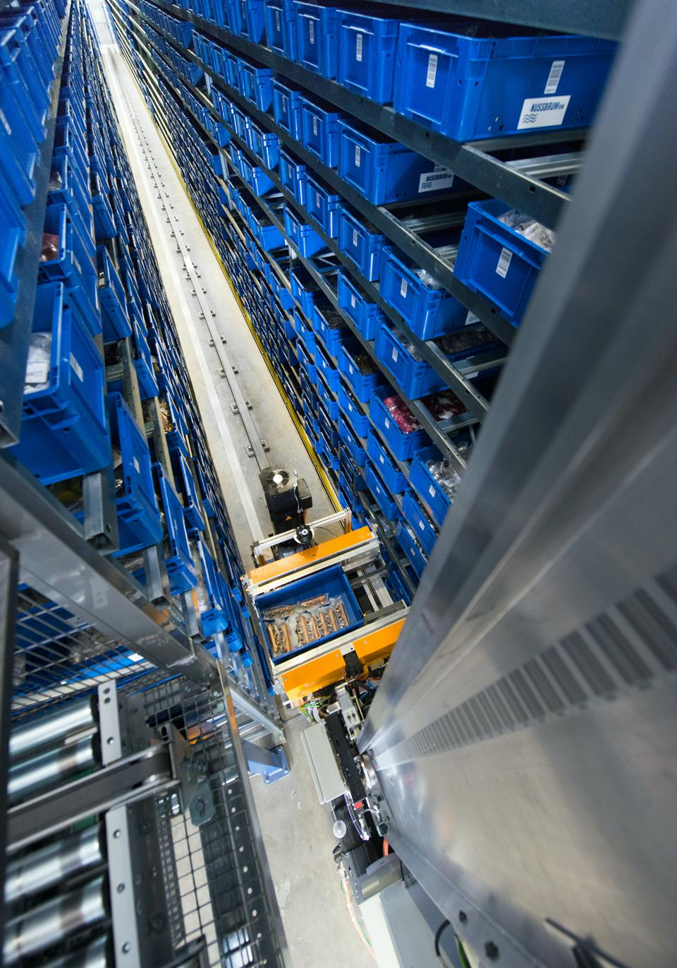 Automated Storage and Retrieval Systems (AS/RSs) operate in 100-feet-tall environments.