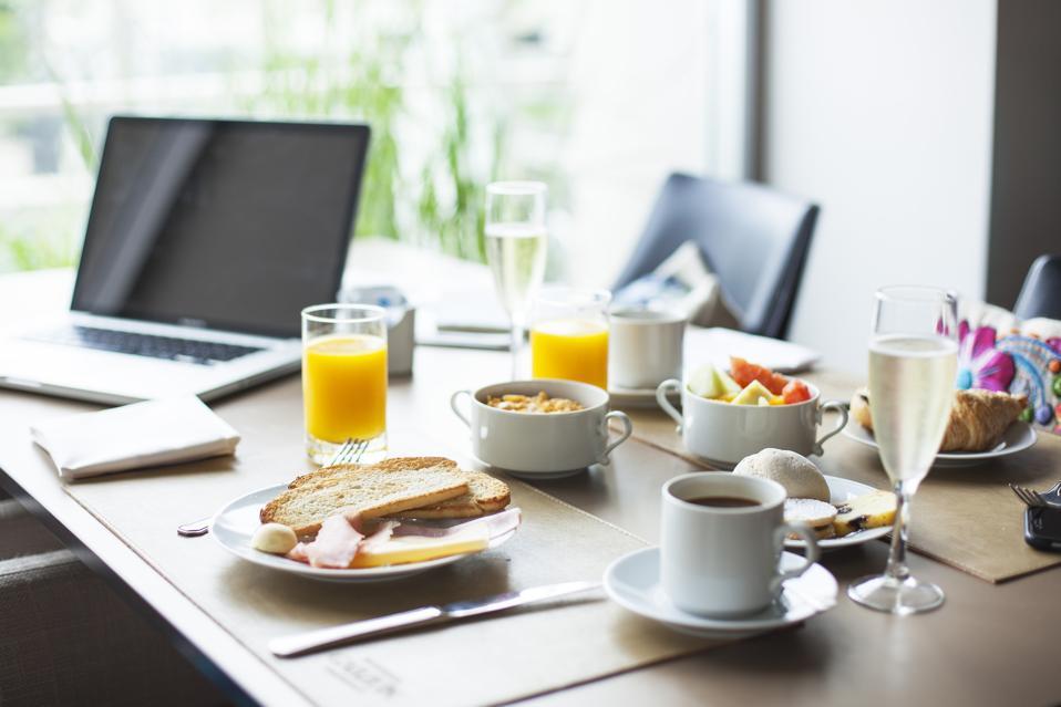 Breakfast on table beside laptop computer