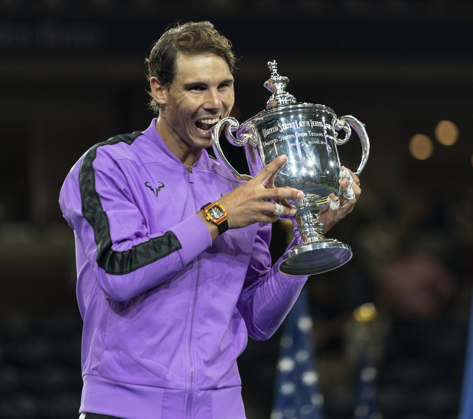 Rafael Nadal (Spain) poses with trophy after winning mens U.S. Open
