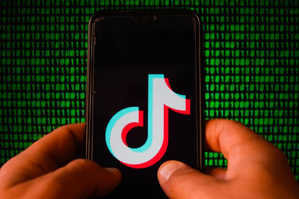 TikTok logo displayed on a smartphone