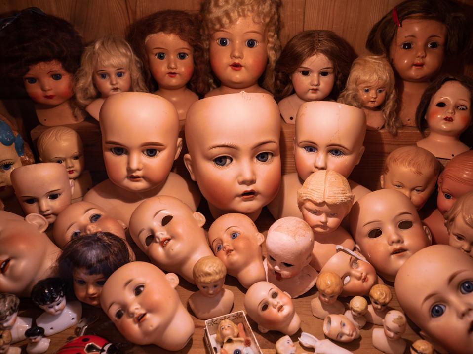 creepy dolls heads lots of eyes