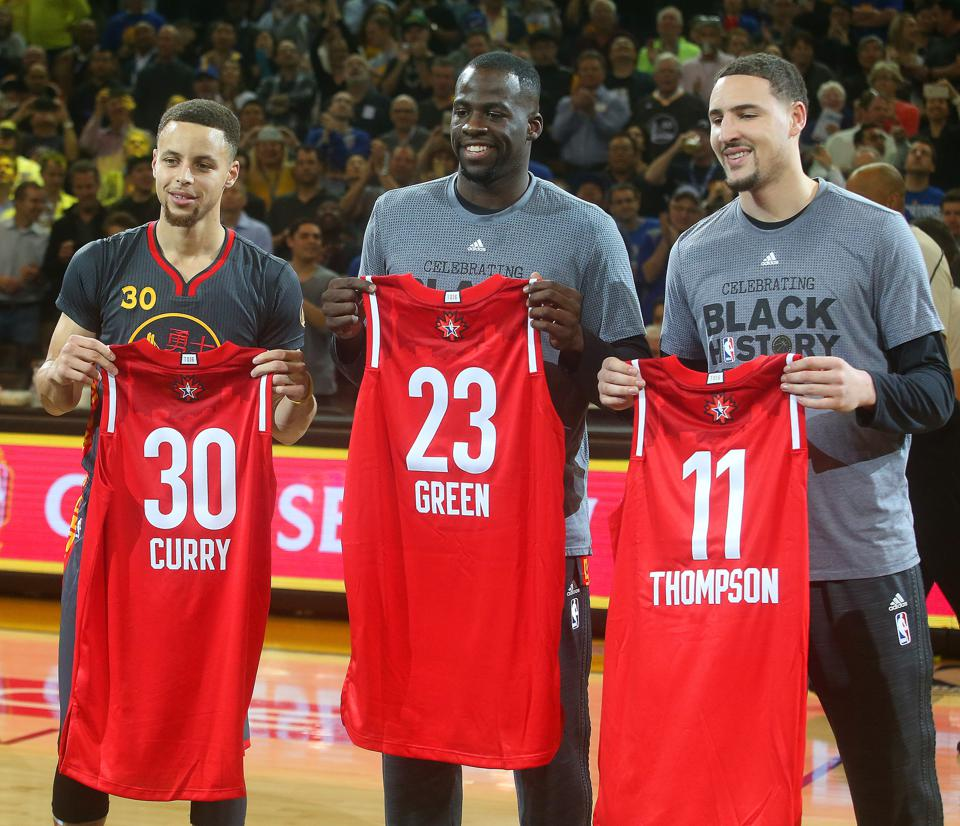 Golden State Warriors players Stephen Curry, Draymond Green and Klay Thompson, from left, are photographed with their All-Star jerseys before the start  their NBA game against the Houston Rockets on Tuesday, Feb. 9, 2016, at Oracle Arena in Oakland, Calif