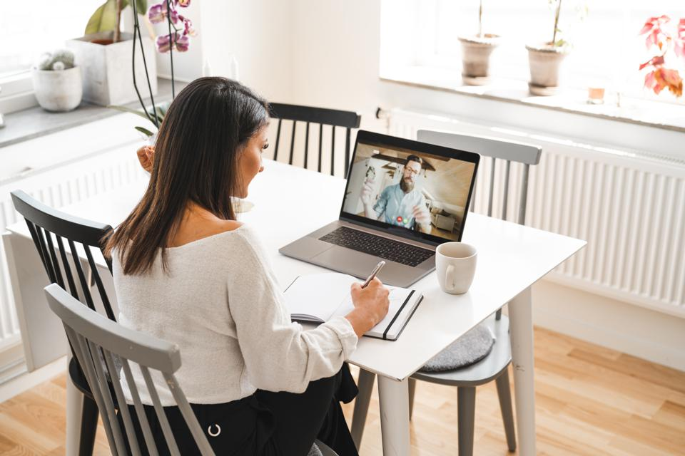 Working woman is video conferencing from home