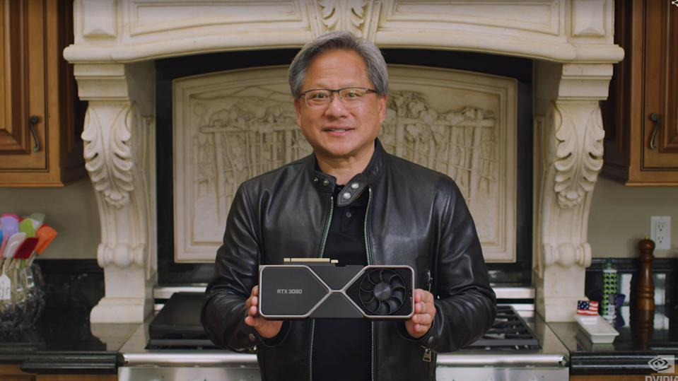 Nvidia CEO Jensen Huang holding a graphics card in his kitchen