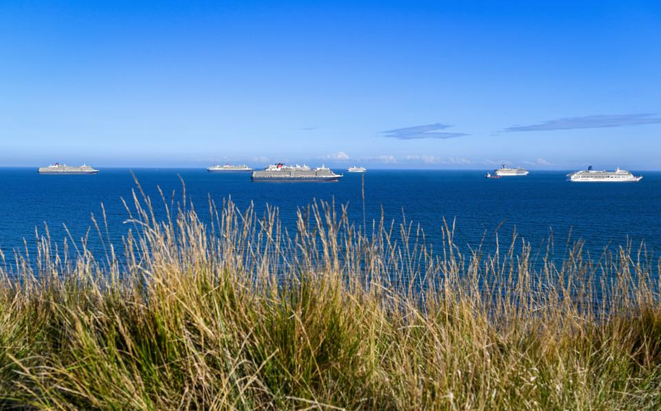 Cruise ships anchored in the English Channel off the Dorset coast in August 2020