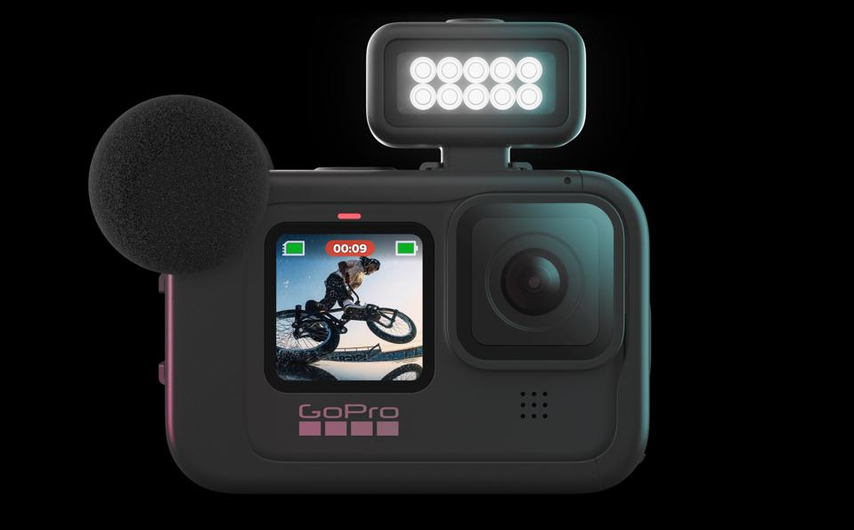 GoPro Hero 9 Black with Media Mod, light, and wind-protector over the mic.