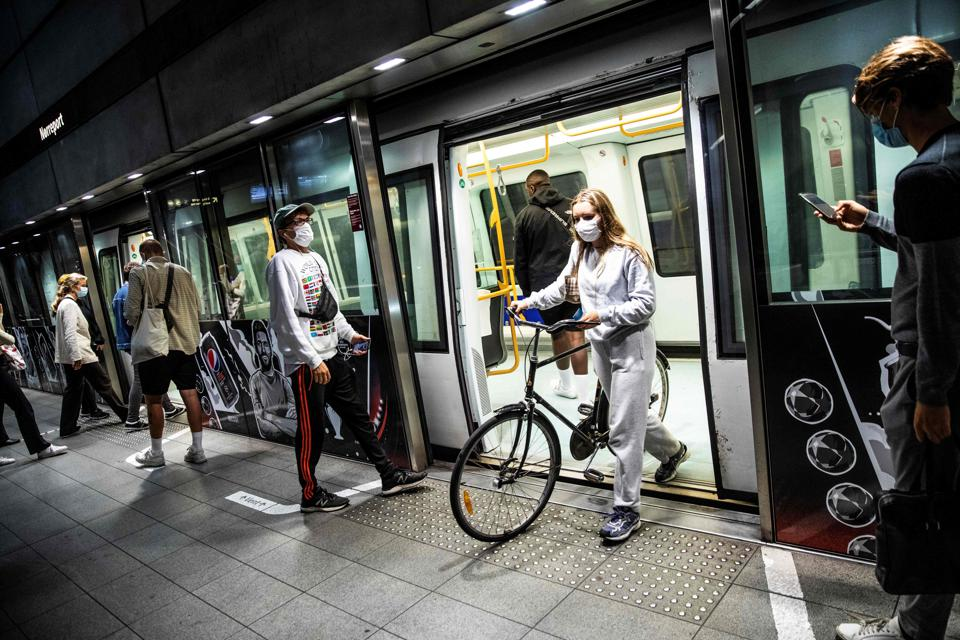 People wearing face masks at a metro station in Copenhagen, Denmark.