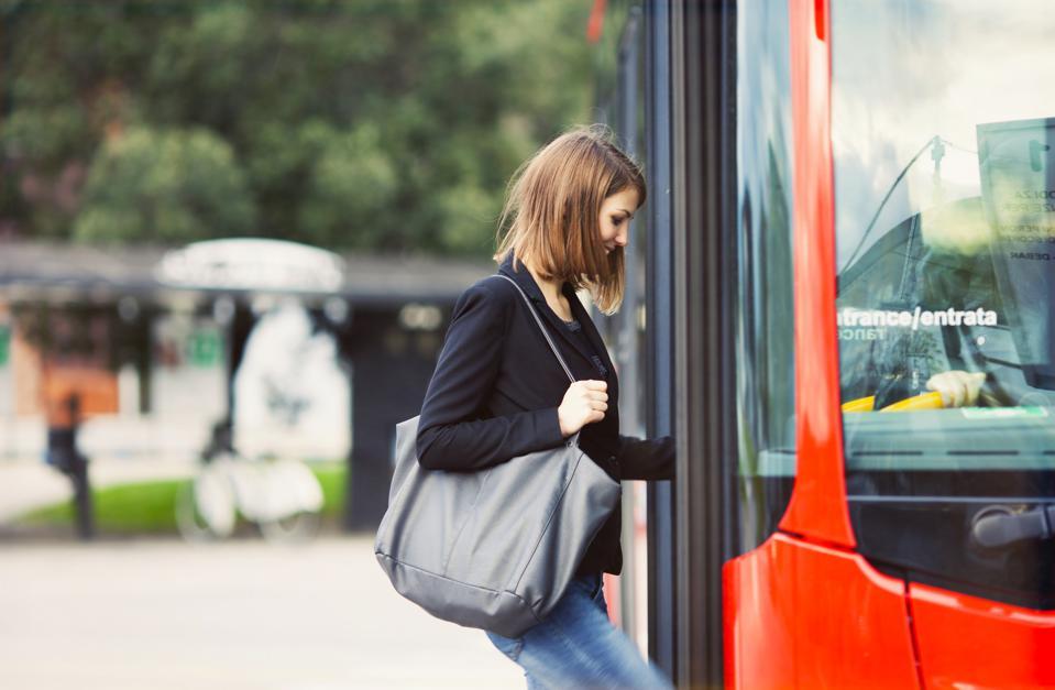 Young traveler boarding a bus