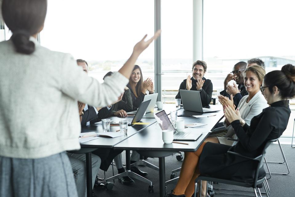 Businesswoman doing presentation in big boardroom