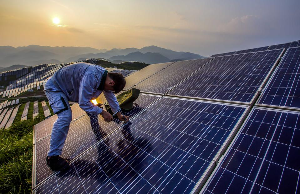 Worker at China Fujian Solar Station In The Mountains