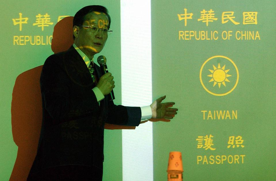 Taiwan Foreign Minister Eugene Chien shows Taiwan's previous passport design.