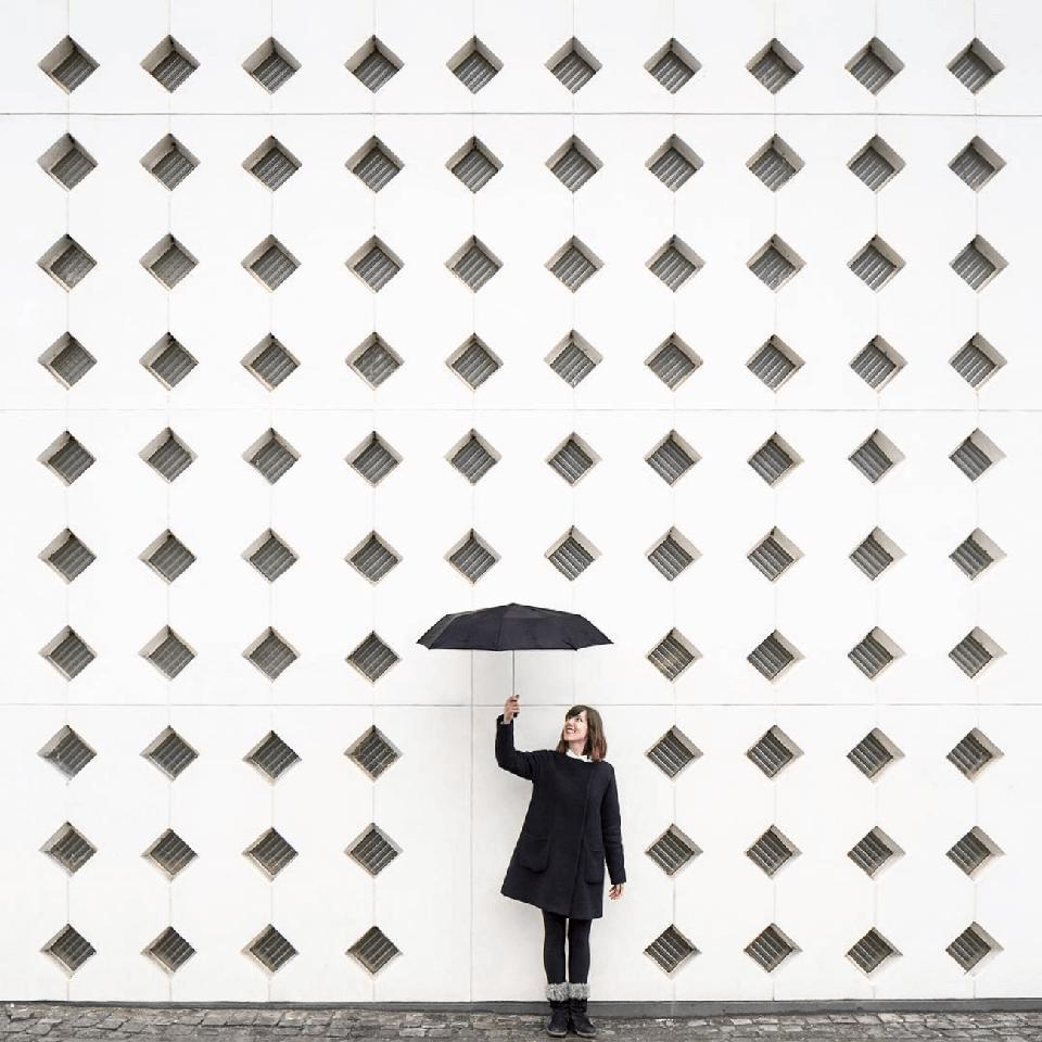 Architect and photographer Anna Devis with an umbrella.