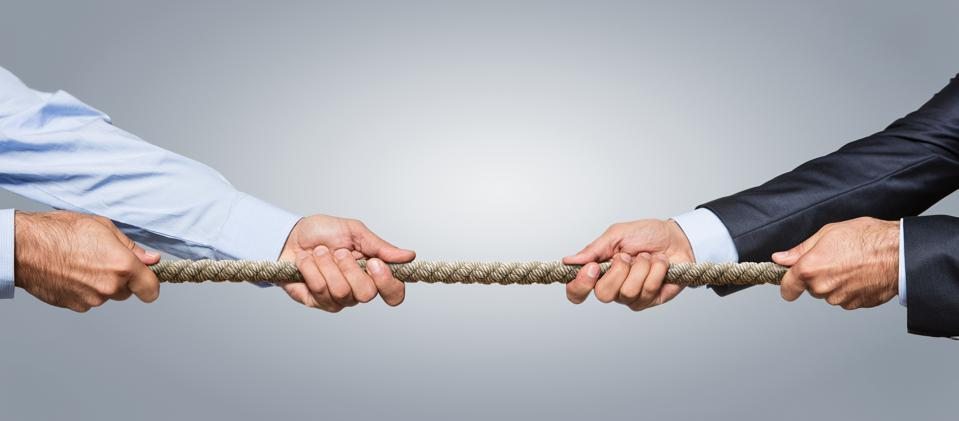 Business competition concept using tug-of-war