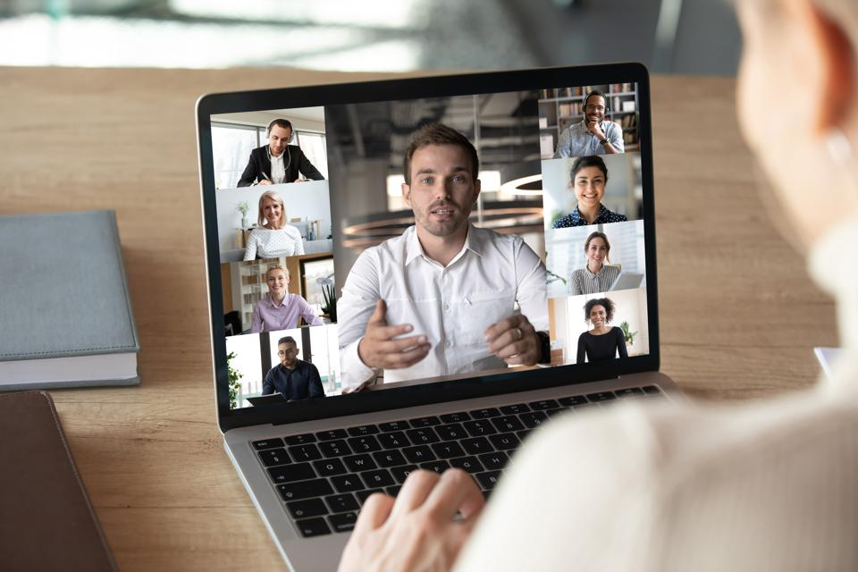 Female employee talk on video call with diverse colleagues