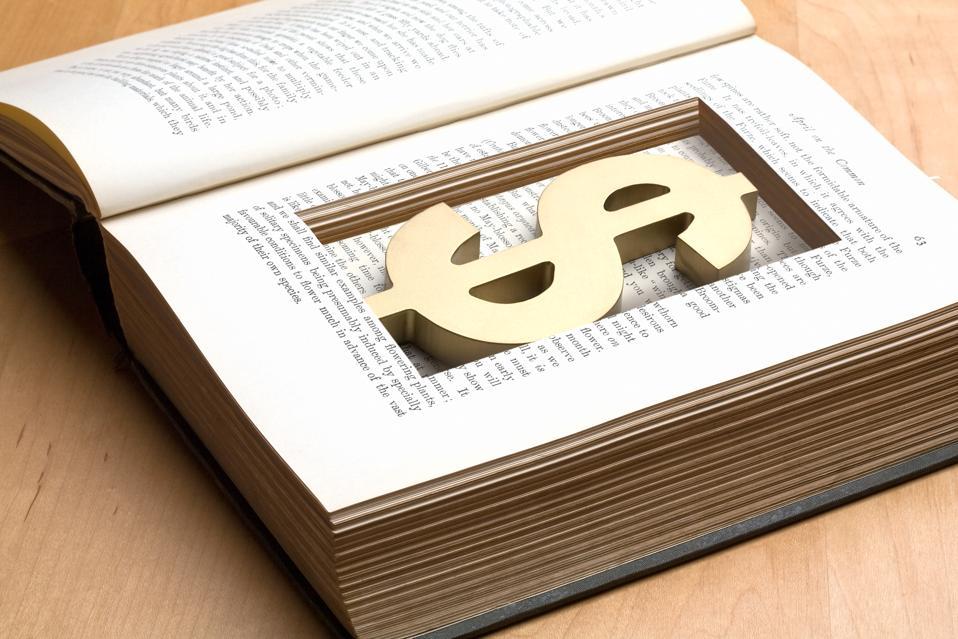dollar symbol in cutout inside book