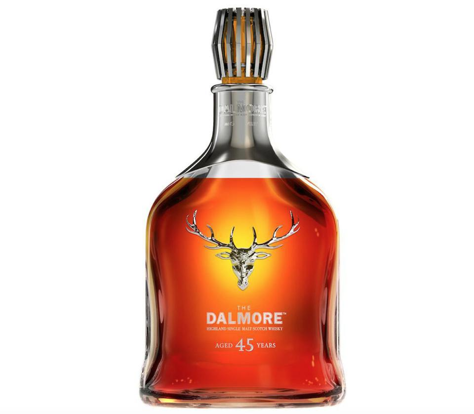 A brilliant auburn-orange blast of liquid in a crystal decanter embossed with a stagshead