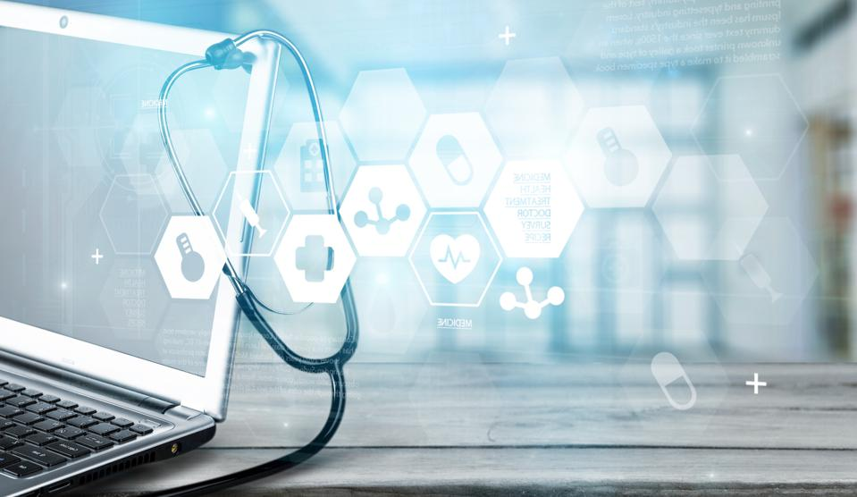 Computer with stethoscope and digital health icons