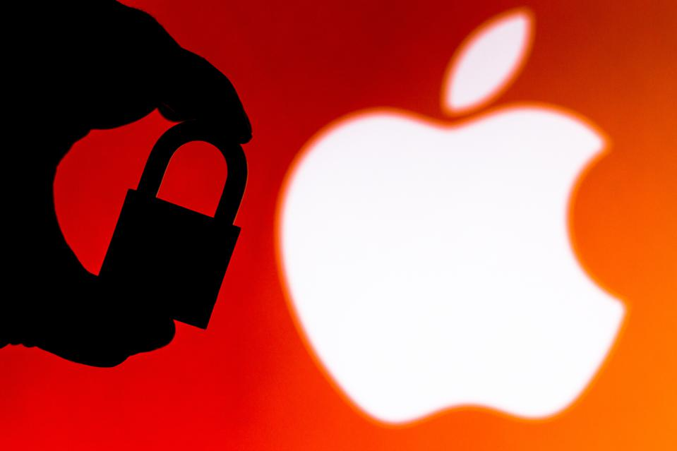 In this photo illustration a padlock appears next to the iOS...
