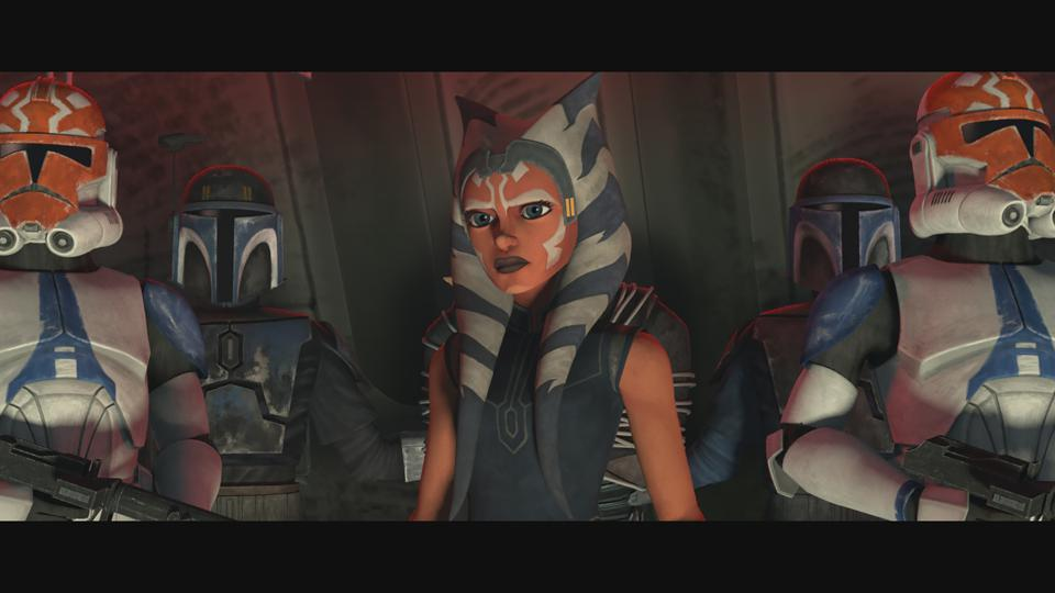 Ahsoka Tano surrounded by Clone Troopers bearing helmets with her face markings.