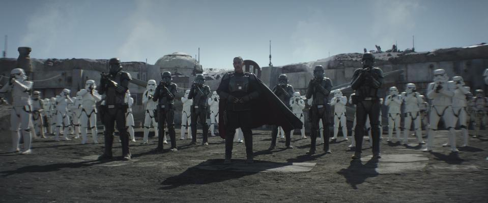 Moff Gideon surrounded by white Storm Troopers and Black Death Troopers in season one of The Mandalorian.