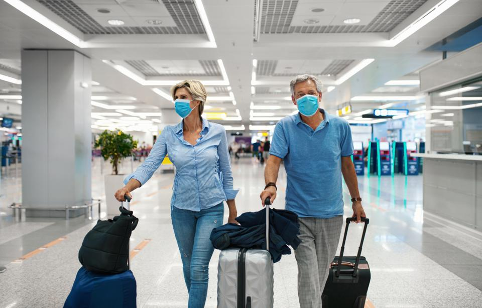 Couple at an airport during coronavirus pandemic.