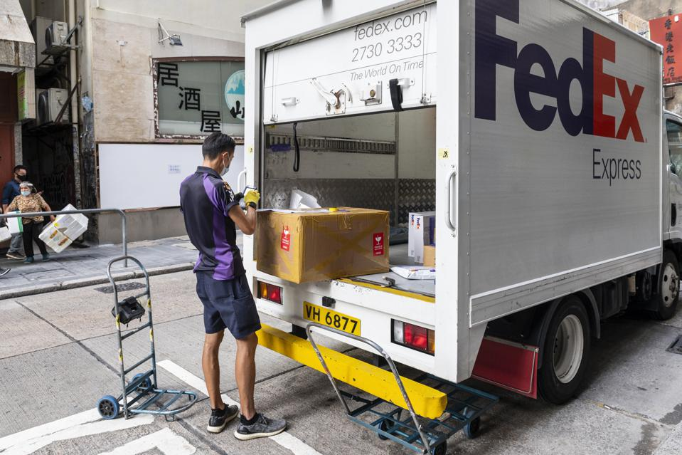 A FedEx Express courier prepares  packages inside...