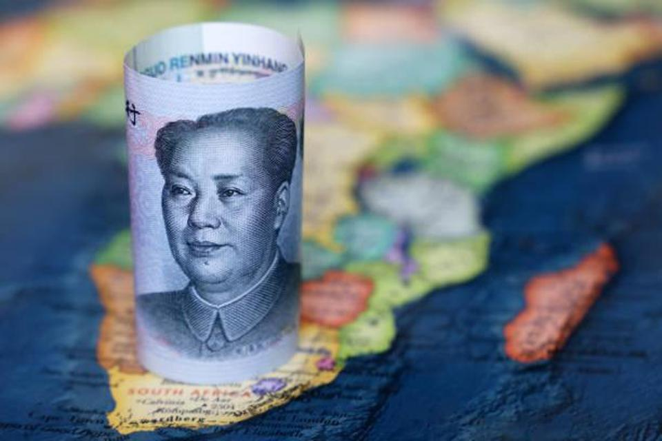 Chinese Yuan note atop a map of Africa
