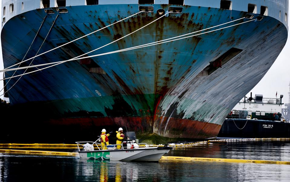 oil  spill leaked from a cargo ship at berth 202