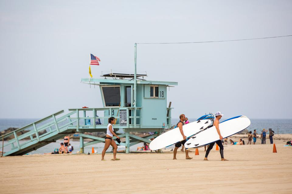 Surfers in Venice Beach, Calif. Californians have been vacationing closer to home during the pandemic.