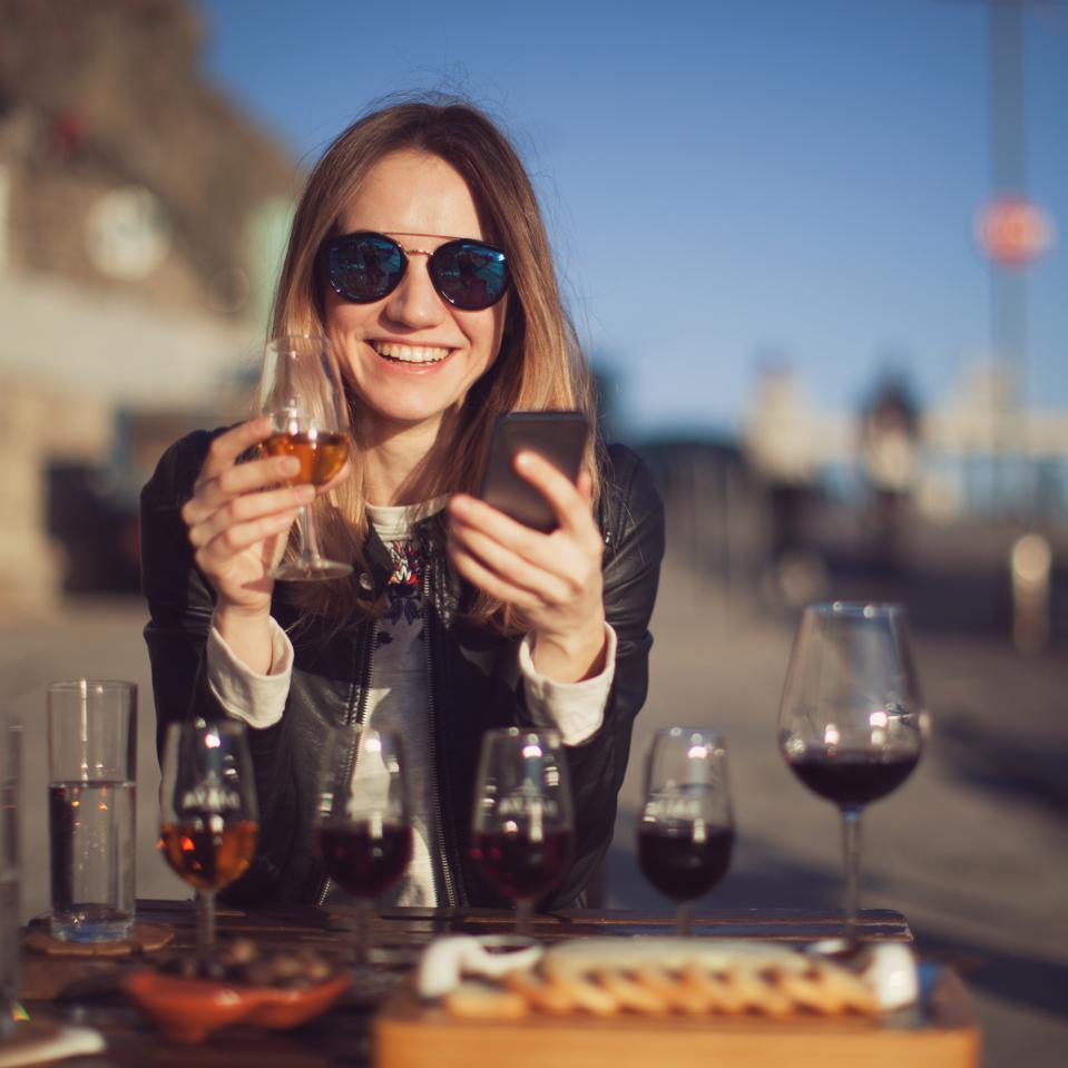 Millennials are discovering the world of Port wine.Woman with wine testing glasses