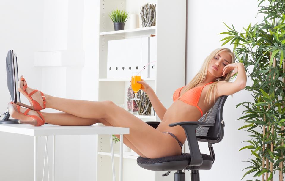 Woman at office in a bikini