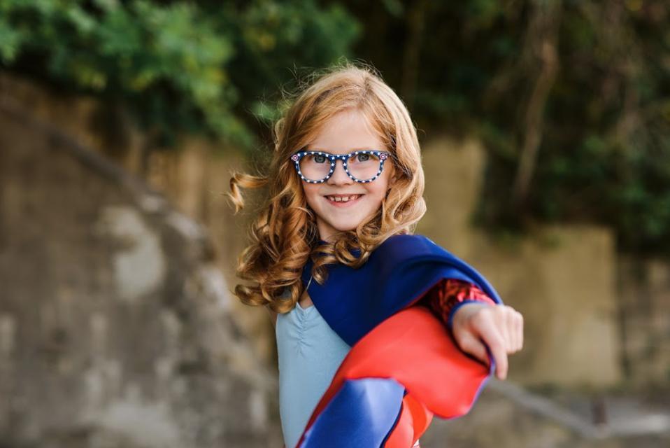 A girl in superhero glasses