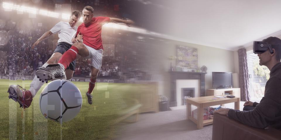 Man At Home With VR Headset Watching Virtual Reality Soccer