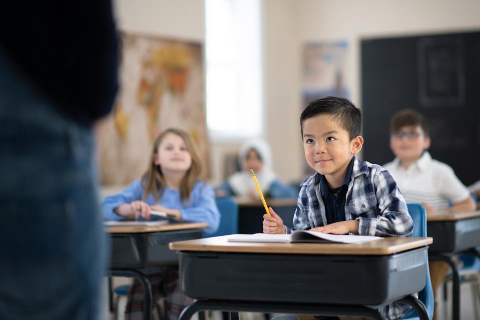 Students Listening to Their Teacher Speak