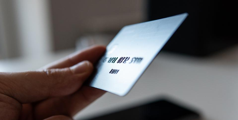 Cropped Hand Of Person Holding Credit Card