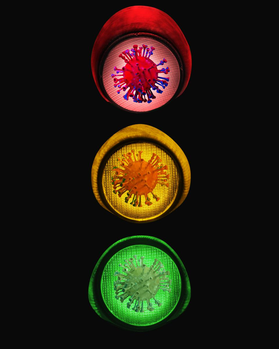 Symbol Of Virus On Traffic Lights Showing Red Amber And Green
