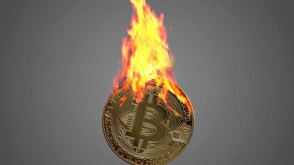 One golden Bitcoin coin with flames.