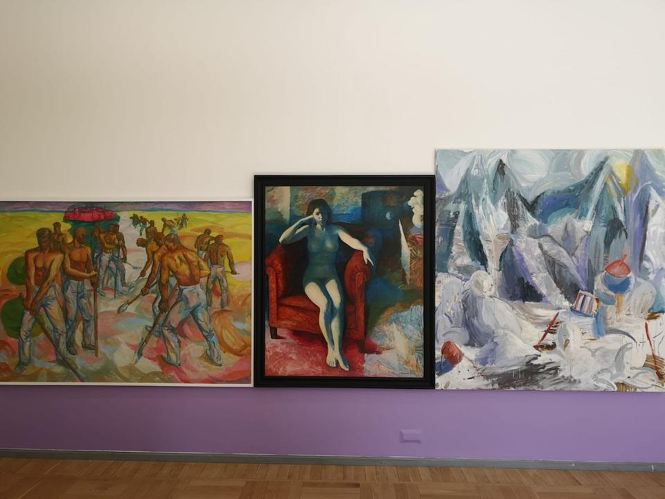 three paintings on wall
