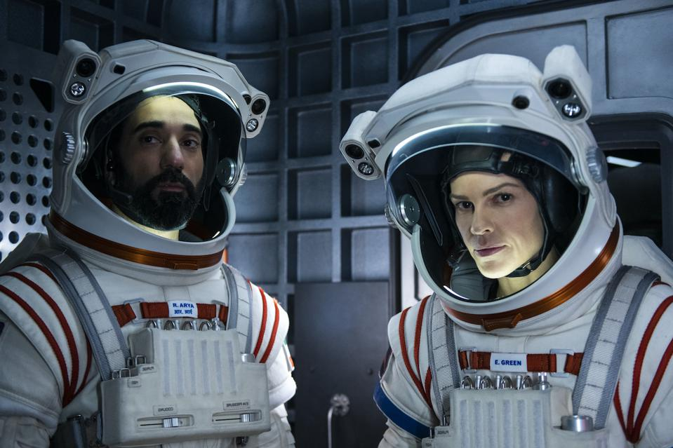 Ray Panthaki and Hilary Swank star in the new Netflix drama 'Away'. Mission to Mars, space travel, NASA, outer space, the moon, exploration. Pandemic, Covid-19.