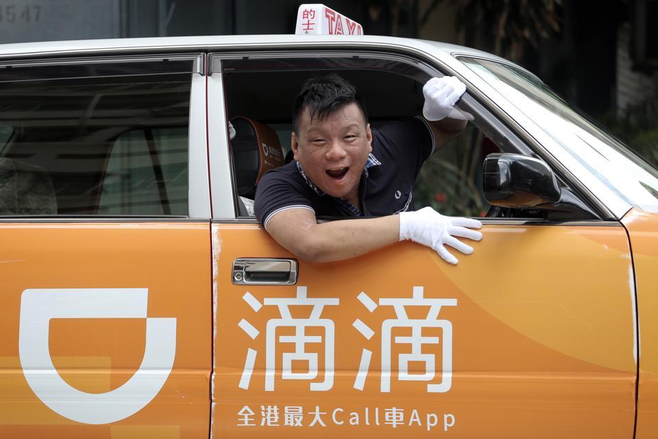 Ng Shu-kei, City Manager of Didi Chuxing Hong Kong, poses in a taxi at Jordan. 04JUL16 SCMP/Paul Yeung
