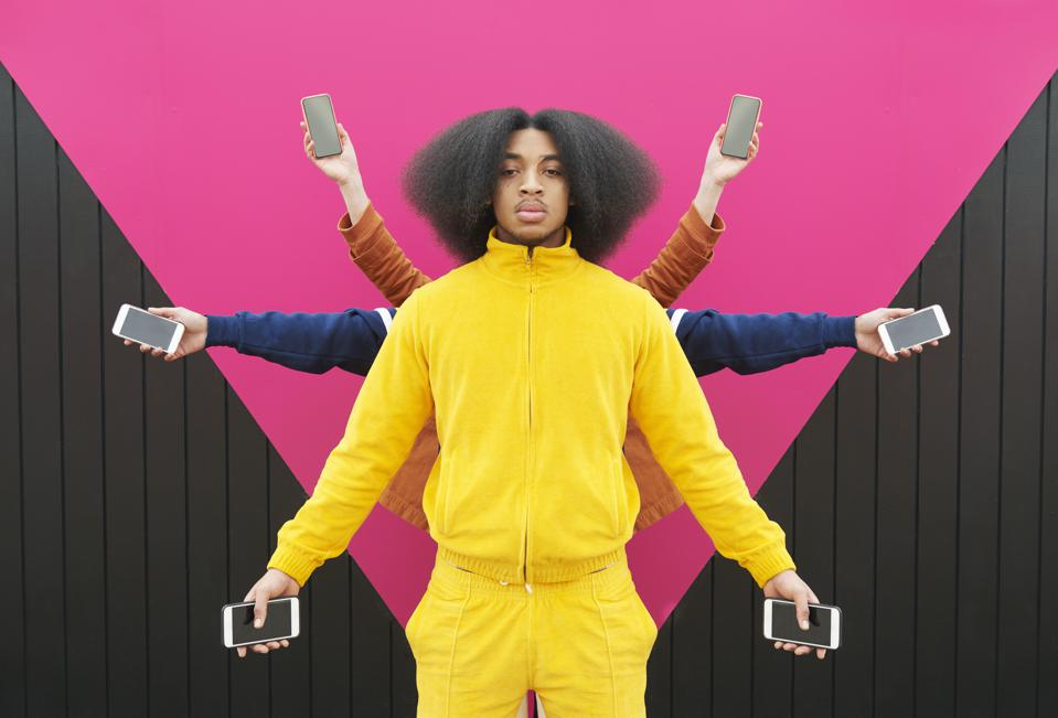Multiple people holding phones out at arms length