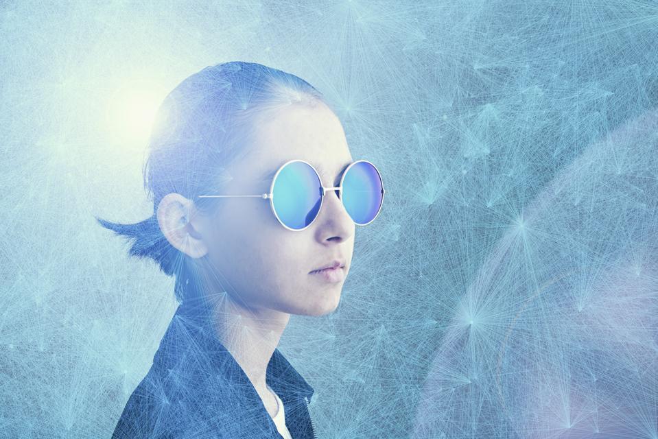 Mixed Race girl wearing sunglasses in cyberspace