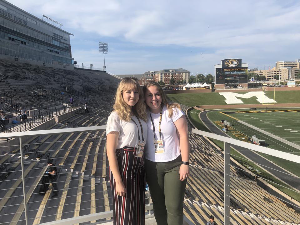 Christina Long (left) and Emily Leiker (right) covering Missouri's home opener against WVU in September 2019.