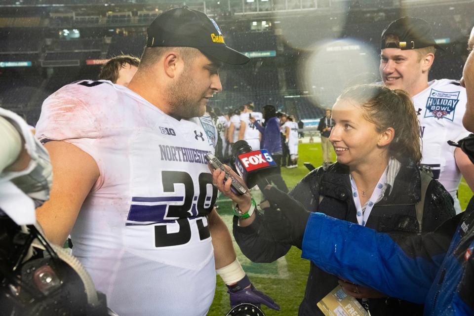 HANDOUT PHOTO: Ella Brockway, a senior at Northwestern University, interviews Wildcats offensive lineman Trey Klock after the 2018 Holiday Bowl in San Diego.