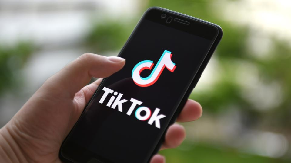 In this photo illustration a TikTok logo displayed on a...